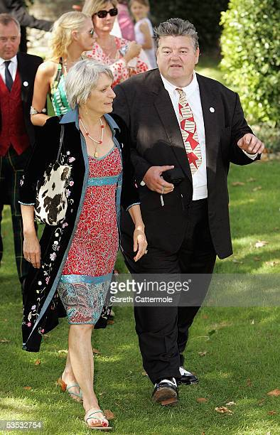 Robbie Coltrane and guest attend the wedding of musician Jools Holland and Christabel McEwen at St James's Church on August 30 2005 in Cooling...