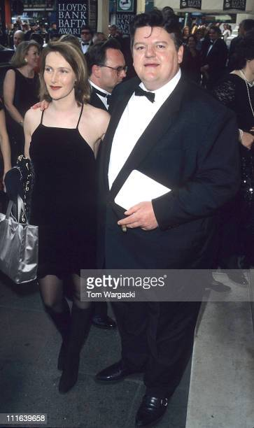Robbie Coltrane and Guest during 48th Annual BAFTA Awards at The Royal Albert Hall in London Great Britain