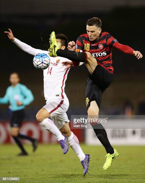 Robbie Cornthwaite of the Wanderers is challenged by Li Shenglong of Shanghai during the AFC Asian Champions League Group Stage match between the...