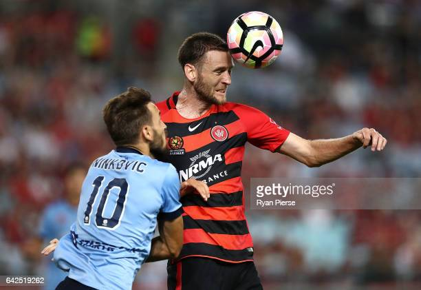 Robbie Cornthwaite of the Wanderers wins the ball over Milos Ninkovic of Sydney FC during the round 20 ALeague match between the Western Sydney...