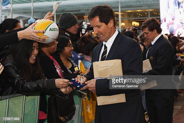 Robbie Deans coach of the Wallabies signs autographs during the Australian Wallabies IRB Rugby World Cup 2011 official team welcome ceremony at Aotea...