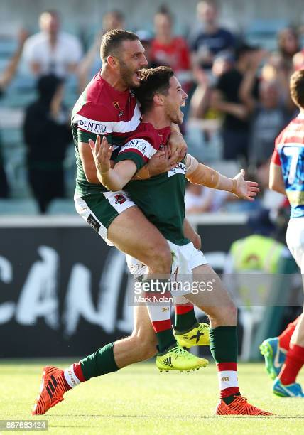 Robbie Farah and Mitchell Moses of Lebanon celebrate a try by Mitchell Moses during the 2017 Rugby League World Cup match between France and Lebanon...