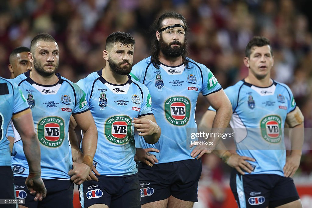 Robbie Farah, Josh Mansour, Aaron Woods and Greg Bird of the Blues looks dejected after a try during game two of the State Of Origin series between the Queensland Maroons and the New South Wales Blues at Suncorp Stadium on June 22, 2016 in Brisbane, Australia.