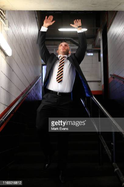 Robbie Farah jumps up to touch the roof of the players tunnel after announcing his retirement during a Wests Tigers NRL media opportunity at...
