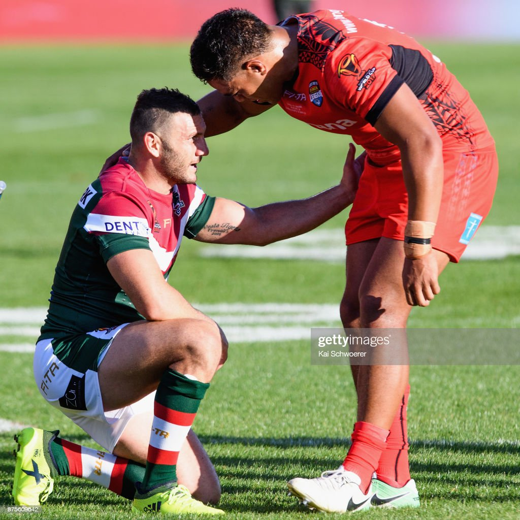 Robbie Farah of Lebanon (L) is consoled by a Tongan player following the 2017 Rugby League World Cup Quarter Final match between Tonga and Lebanon at AMI Stadium on November 18, 2017 in Christchurch, New Zealand.