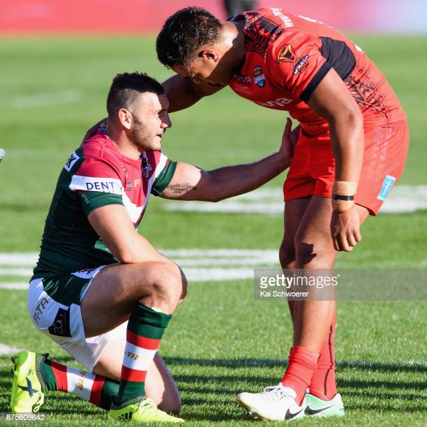 Robbie Farah of Lebanon is consoled by a Tongan player following the 2017 Rugby League World Cup Quarter Final match between Tonga and Lebanon at AMI...