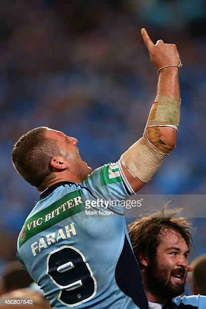 Robbie Farah of the Blues and Aaron Woods of the Blues celebrate winning the series after game two of the State of Origin series between the New...