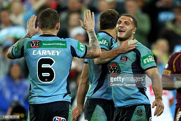 Robbie Farah of the Blues celebrates with team mate Todd Carney after winning game two of the ARL State of Origin series between the New South Wales...