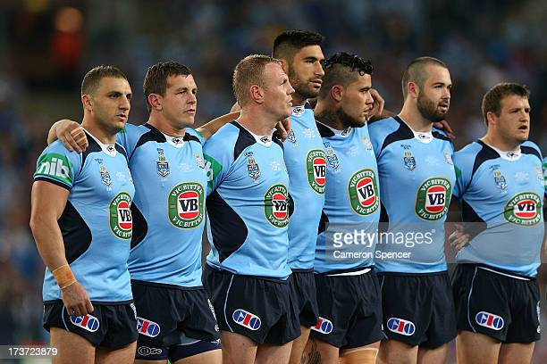 Robbie Farah of the Blues sing the national anthem before game three of the ARL State of Origin series between the New South Wales Blues and the...
