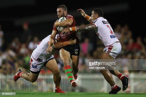 Robbie Farah of the Rabbitohs is tackled during the NRL trial match between the South Sydney Rabbitohs and the St George Illawarra Dragons at Glen...