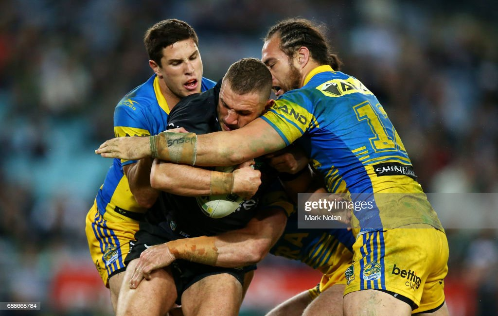 Robbie Farah of the Rabbitohs is tackled during the round 12 NRL match between the South Sydney Rabbitohs and the Parramatta Eels at ANZ Stadium on May 26, 2017 in Sydney, Australia.