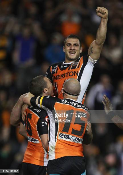 Robbie Farah of the Tigers celebrates kicking the winning field goal in golden point time during the round 13 NRL match between the Wests Tigers and...