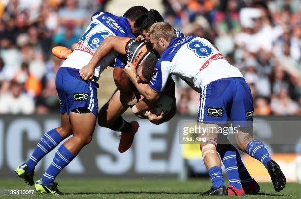 Robbie Farah of the Tigers is tackled during the round three NRL match between the Wests Tigers and the Canterbury Bulldogs at Campbelltown Stadium...