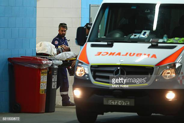 Robbie Farah of the Tigers is transfered to an ambulance after leaving the field with an injury during the round 10 NRL match between the Wests...