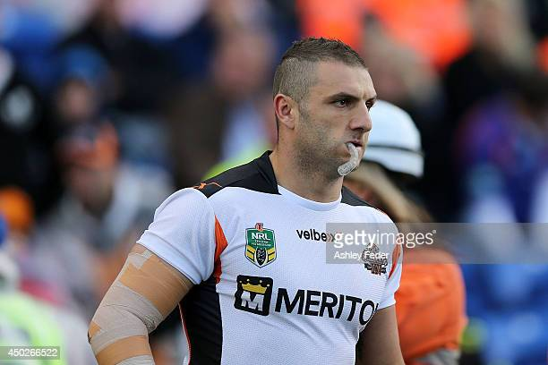 Robbie Farah of the Tigers leads his team out onto the field during the round 13 NRL match between the Newcastle Knights and the Wests Tigers at...