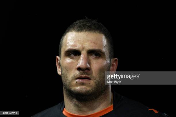 Robbie Farah of the Tigers looks dejected during the round 23 NRL match between the Wests Tigers and the Sydney Roosters at Leichhardt Oval on August...