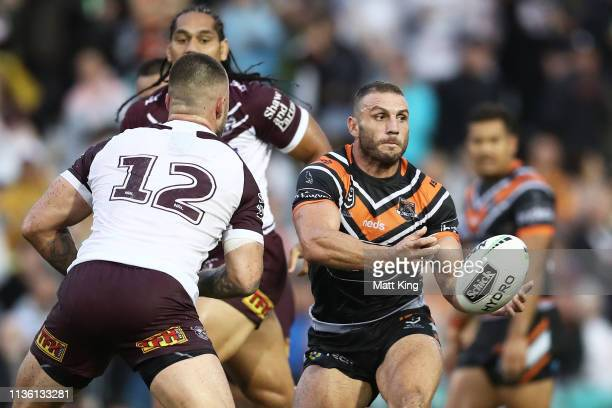 Robbie Farah of the Tigers passes during the round 1 NRL match between the Wests Tigers and the Manly Warringah Sea Eagles at Leichhardt Oval on...
