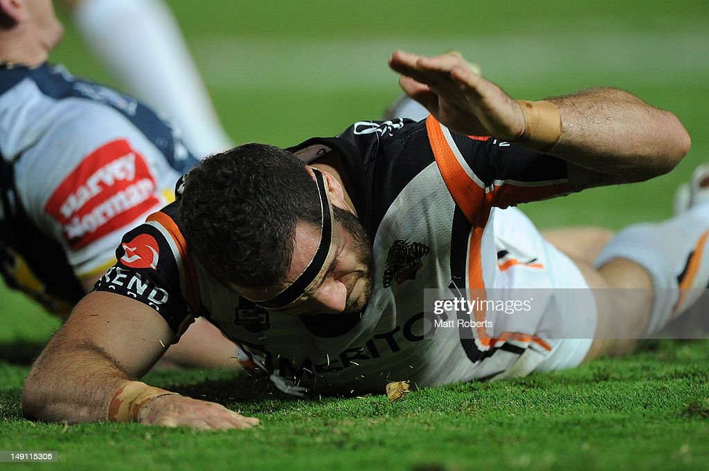 Robbie Farah of the Tigers reacts during the round 20 NRL match between the North Queensland Cowboys and the Wests Tigers at Dairy Farmers Stadium on July 23, 2012 in Townsville, Australia.