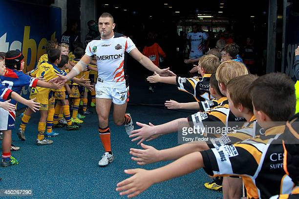 Robbie Farah of the Tigers runs onto the ground before the game during the round 13 NRL match between the Newcastle Knights and the Wests Tigers at...