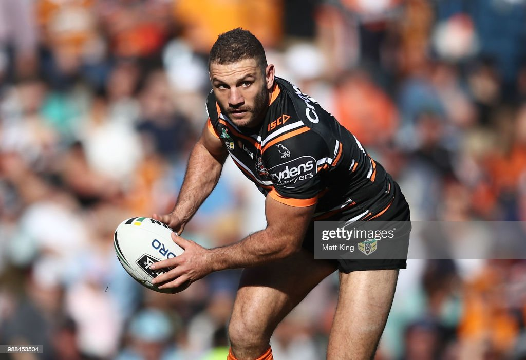 Robbie Farah of the Tigers runs with the ball during the round 16 NRL match between the Wests Tigers and the Gold Coast Titans at Leichhardt Oval on July 1, 2018 in Sydney, Australia.