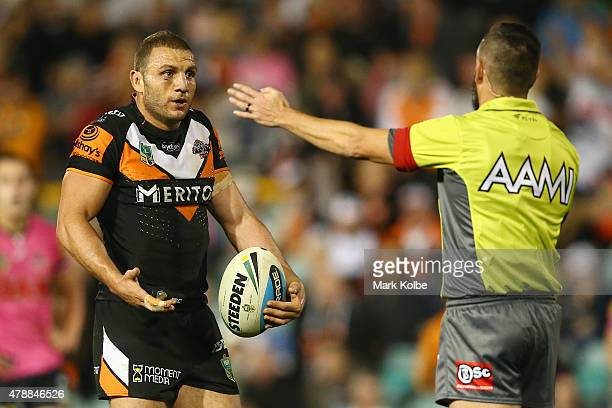 Robbie Farah of the Wests Tigers appeals to referee Gavin Badger during the round 16 NRL match between the Wests Tigers and the Penrith Panthers at...