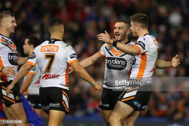 Robbie Farah of the Wests Tigers celebrates the win over the Knights during the round 19 NRL match between the Newcastle Knights and Wests Tigers at...