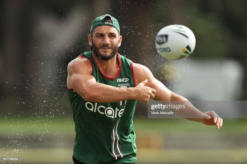 Robbie Farah passes a wet ball during a South Sydney Rabbitohs NRL training session at Redfern Oval on February 12, 2018 in Sydney, Australia.