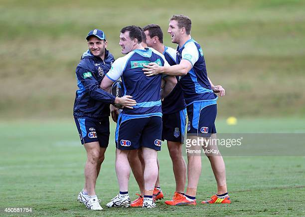 Robbie Farah Paul Gallen and Ryan Hoffman group together during a New South Wales State of Origin training session at Novotel Coffs Harbour on June...