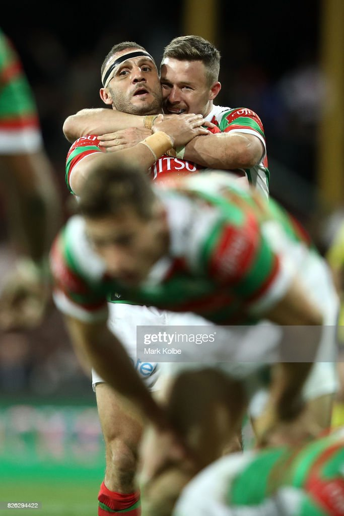 Robbie Farrah and Damien Cook of the Rabbitohs celebrate victory during the round 22 NRL match between the St George Illawarra Dragons and the South Sydney Rabbitohs at Sydney Cricket Ground on August 4, 2017 in Sydney, Australia.