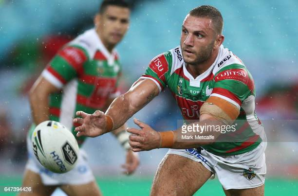 Robbie Farrah of the Rabbitohs passes during the round one NRL match between the South Sydney Rabbitohs and the Wests Tigers at ANZ Stadium on March...
