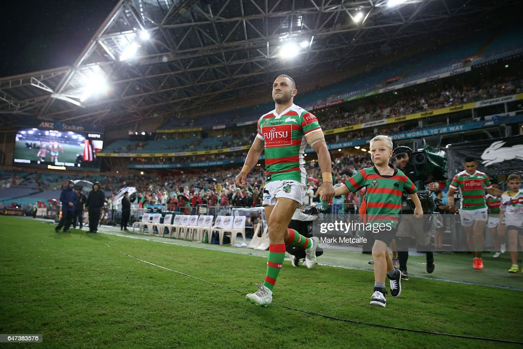 Robbie Farrah of the Rabbitohs runs onto the field during the round one NRL match between the South Sydney Rabbitohs and the Wests Tigers at ANZ Stadium on March 3, 2017 in Sydney, Australia.