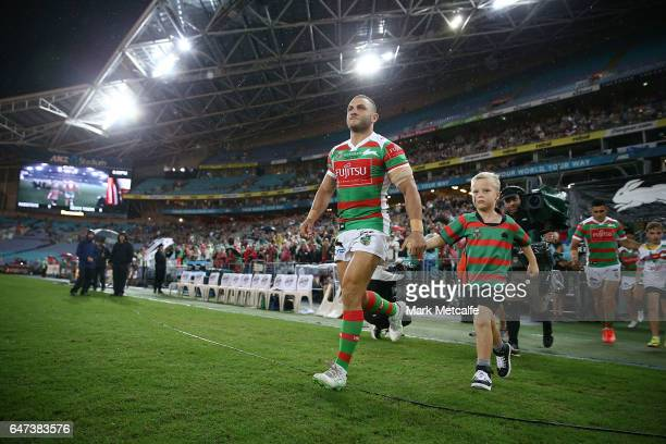 Robbie Farrah of the Rabbitohs runs onto the field during the round one NRL match between the South Sydney Rabbitohs and the Wests Tigers at ANZ...