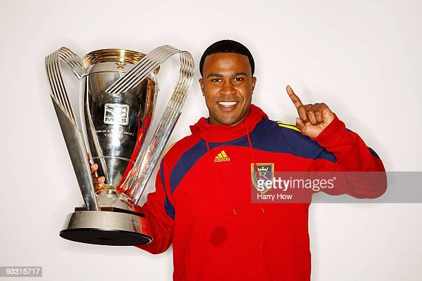 Robbie Findley of Real Salt Lake poses with the Philip F Anschutz MLS Cup trophy following their win in the MLS Cup final at Qwest Field on November...