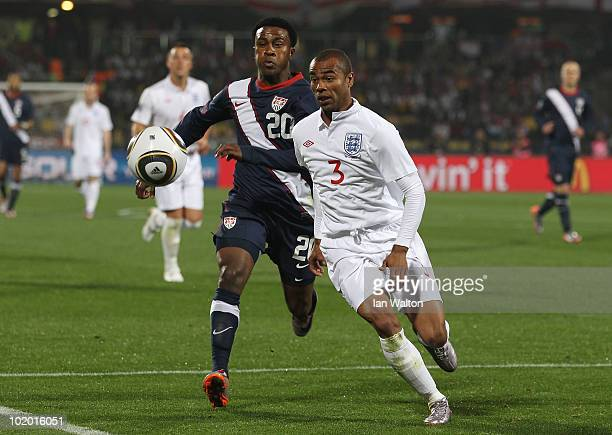 Robbie Findley of the United States and Ashley Cole of England battle for the ball during the 2010 FIFA World Cup South Africa Group C match between...