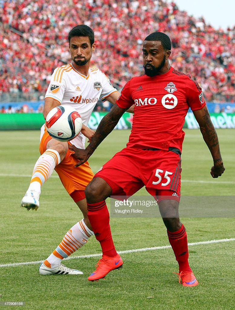 Robbie Findley #55 of Toronto FC battles for the ball with Jermaine Taylor #4 of the Houston Dynamo during an MLS soccer game at BMO Field on May 10, 2015 in Toronto, Ontario, Canada.