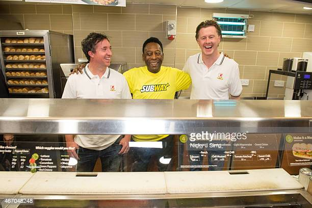 Robbie Fower Pele and Steve McManaman attend Subway Restaurant in New Oxford Street on March 20 2015 in London England