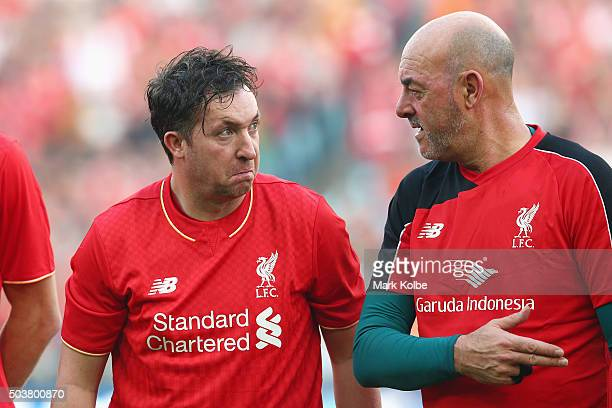 Robbie Fowler and Bruce Grobbelaar speak during the anthem ceremony ahead of the match between Liverpool FC Legends and the Australian Legends at ANZ...