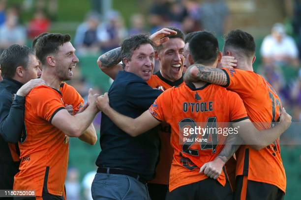 Robbie Fowler coach of the Roar celebrates with his players after a gaol by Roy ODonovan of the Roar during the round one ALeague match between Perth...