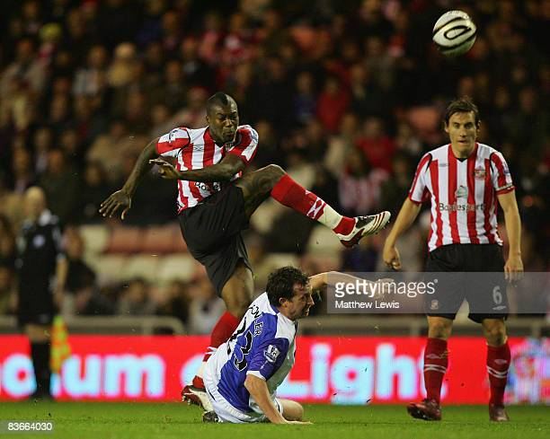 Robbie Fowler of Blackburn Rovers slides in to block the shot of Djibril Cisse of Sunderland during the Carling Cup Fourth Round match between...