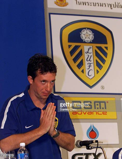 Robbie Fowler of Leeds United greets the Press in a Sawatee Style during a press conference held at the Merchant Court Hotel in Bangkok as Leeds...