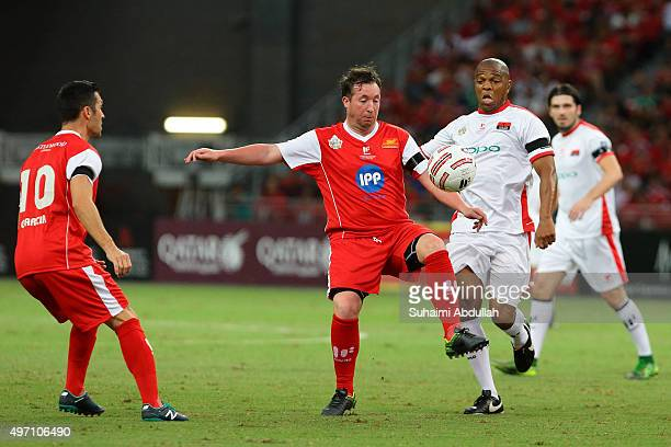 Robbie Fowler of Liverpool and Quinton Fortune of Manchester United challenge for the ball during The Castlewood Group Battle Of The Reds 2015...