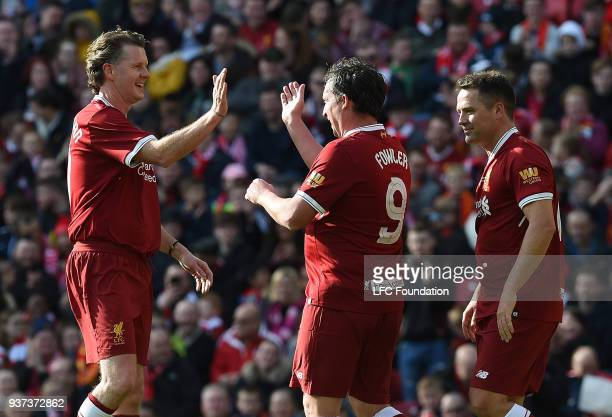 Robbie Fowler of Liverpool celebrates with teammates Steve McManaman and Michael Owen after scoring their third goal during the LFC Foundation...