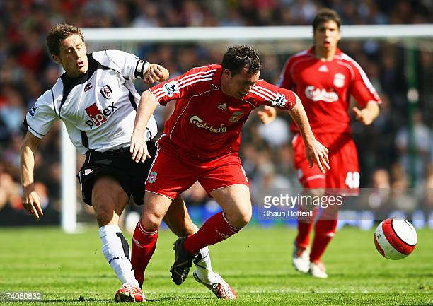 Robbie Fowler of Liverpool evades Michael Brown of Fulham during the Barclays Premiership match between Fulham and Liverpool at Craven Cottage on May...
