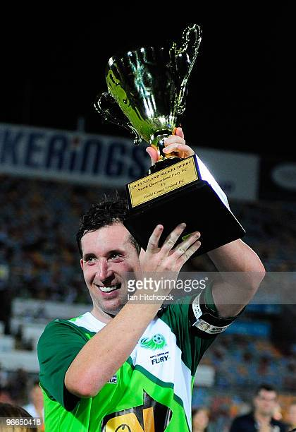 Robbie Fowler of the Fury holds up the Queensland Nickel Cup after wining the round 27 ALeague match between North Queensland Fury and Gold Coast...