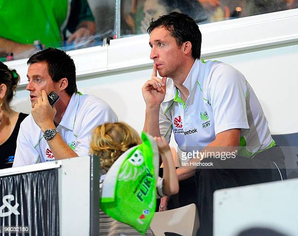 Robbie Fowler of the Fury sits in the grandstand with fellow team mate Terry Cooke during the round 24 ALeague match between the North Queensland...