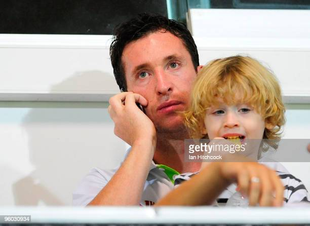 Robbie Fowler of the Fury sits in the grandstand with his son Jacob during the round 24 ALeague match between the North Queensland Fury and the...
