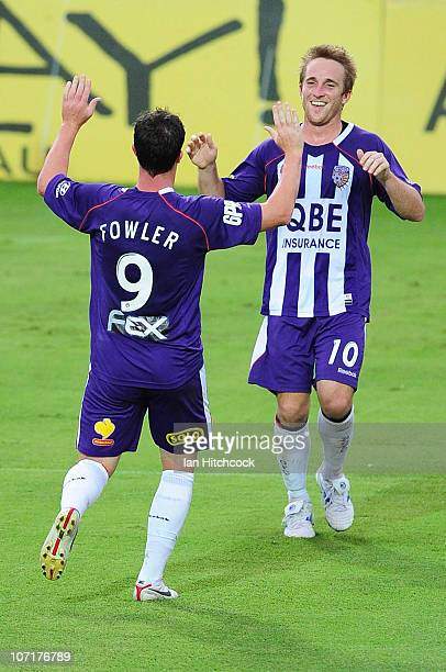 Robbie Fowler of the Glory celebrates his goal with Michael Baird of the Glory runs with the ball during the round 16 ALeague match between the North...
