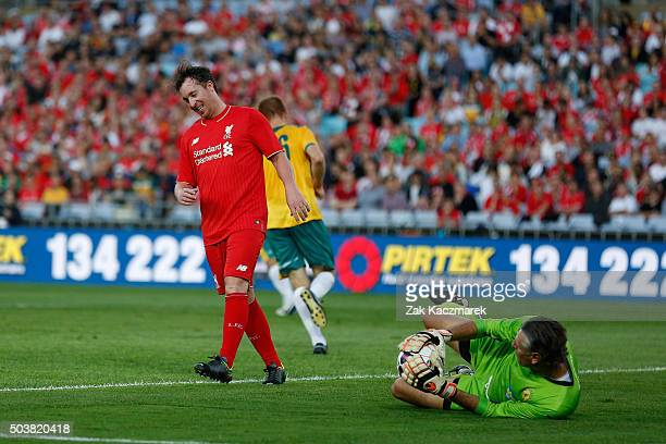 Robbie Fowler of the Liverpool Legends has a shot saved by Zeljko Kalac of the Australian Legends during the match between Liverpool FC Legends and...