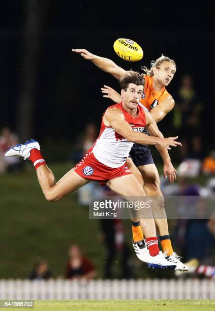 Robbie Fox of the Swans is challenged by Nick Haynes of the Giants during the 2017 JLT Community Series AFL match between the Greater Western Sydney...