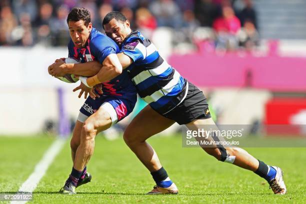 Robbie Fruean of Bath Rugby and Julien Arias of Stade Francais battle for the ball during the European Rugby Challenge Cup match between Stade...